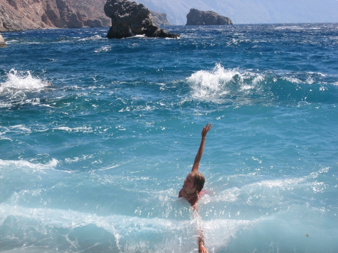 Playing in the waves in Greece