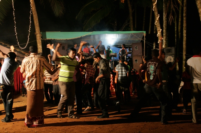 The party in Sri Lanka. Only the men get to dance - the women sit with their babies and watch